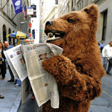 Holy shit that bear can read the newspaper